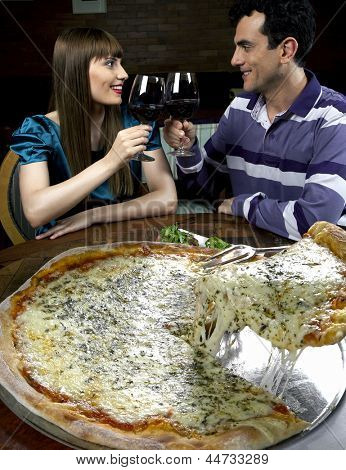 Young couple in pizzeria