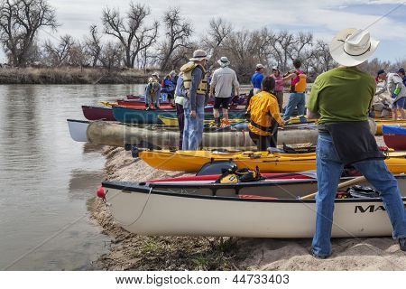 SOUTH PLATTE RIVER, EVANS, COLORADO - APRIL 6: Preparing kayaks and canoes for a launch during Annual All Club Paddle on April 6, 2013, a popular season opening paddling trip in northern Colorado.
