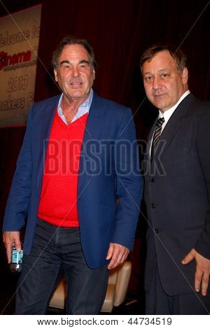 LAS VEGAS - APR 17:  Oliver Stone, Sam Raimi at the CinemaCon Filmmaker's Luncheon at the Caesars Palace on April 17, 2013 in Las Vegas, NV