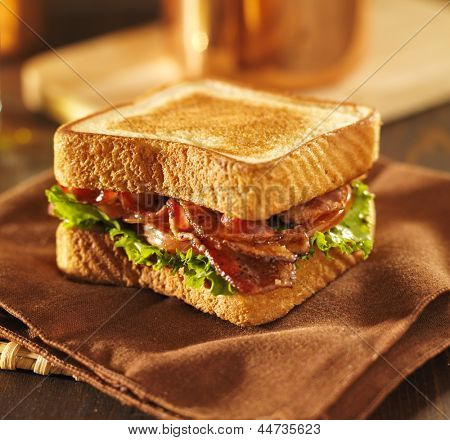 BLT bacon lettuce tomato sandwich on a napkin