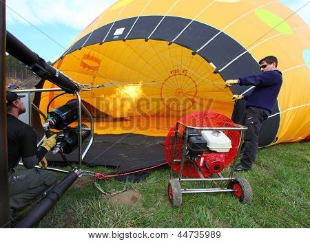 KARLSTEJN, CZECH REPUBLIC - APRIL 14: Unidentified crew preparing hot air baloon to fly. Baloon event on April 14, 2013 in Karlstejn, Czech Republic.