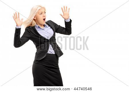 A young businesswoman gesturing fear isolated on white background