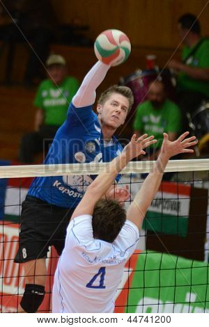 KAPOSVAR, HUNGARY - APRIL 15: Roland Gergye (in blue) in action at a Hungarian National Championship volleyball game Kaposvar (blue) vs. Kecskemet (white), April 15, 2013 in Kaposvar, Hungary.
