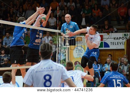KAPOSVAR, HUNGARY - APRIL 15: Unidentified players in action at a Hungarian National Championship volleyball game Kaposvar (blue) vs. Kecskemet (white), April 15, 2013 in Kaposvar, Hungary.