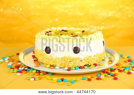 Tasty cake on yellow background