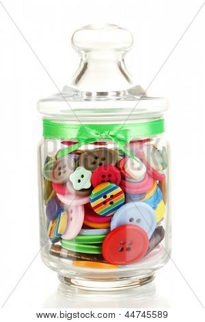 Glass jar containing various colored buttons isolated on white