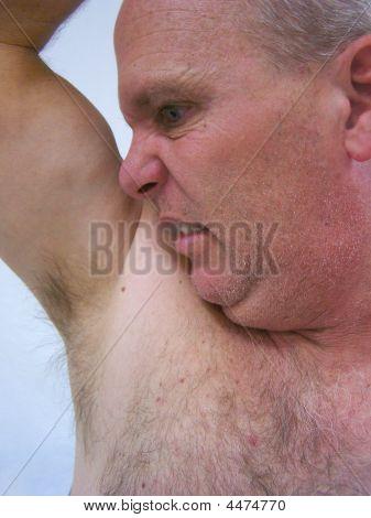 Man Sniffing Armpit.