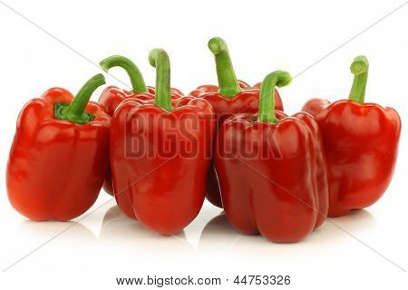 fresh red bell peppers (capsicum) on a white background