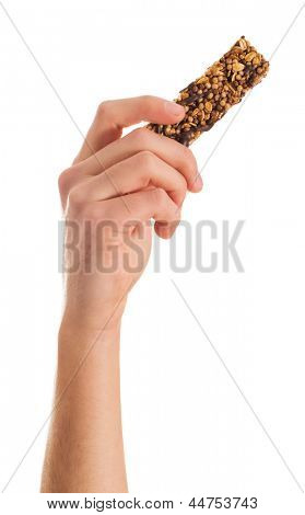 Close-up Of Hand Holding Multigrain Bar On White Background