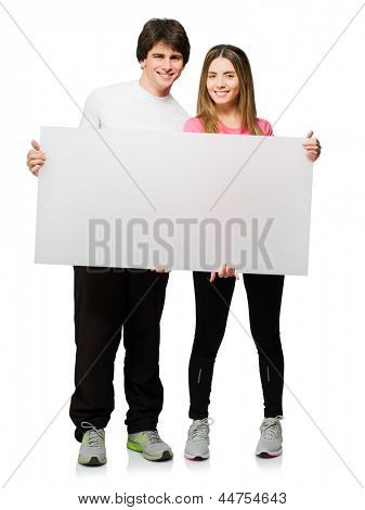 Happy Young Couple Holding Blank Placard Isolated On White Background