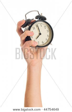 Human Hand Holding Alarm Clock On White Background
