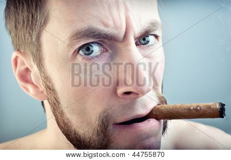 a man with a cigar, looking into the camera