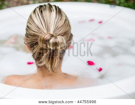 Woman taking a bubble bath - beauty concepts