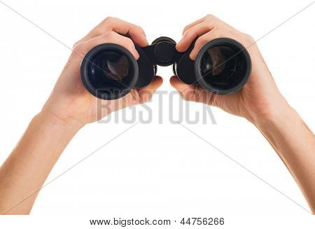 Close-up Of Human Hand Holding Binoculars On White Backgrounds