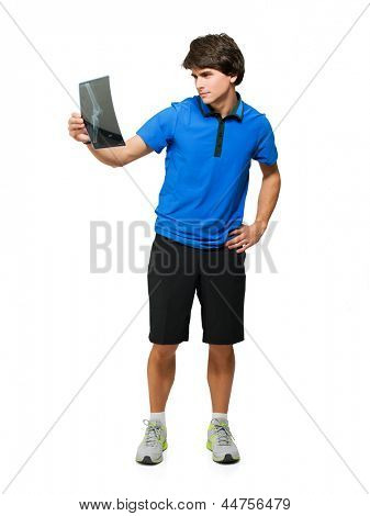 Young Sport Player With X-ray Isolated On White Background
