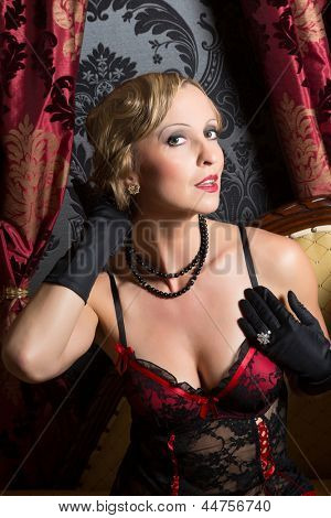 Vintage pose of a sexy young woman in twenties style corset
