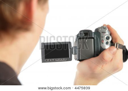 Man With Camcorder In Hand From Back