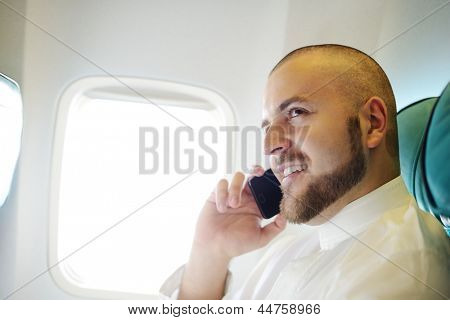 Arabic businessman in the Middle east speaking on cell phone