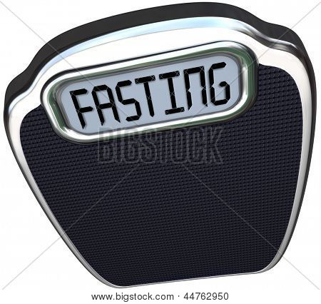 The word Fasting on a digital display of a scale to represent the new 5:2 diet fad or craze in which you reduce calories for two days and eat normally for five