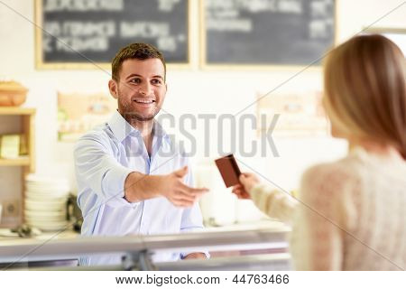 Wman with a credit card at the counter