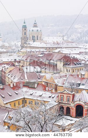 winter roofs of Ledebursky palace and St. Nicolas church, Prague