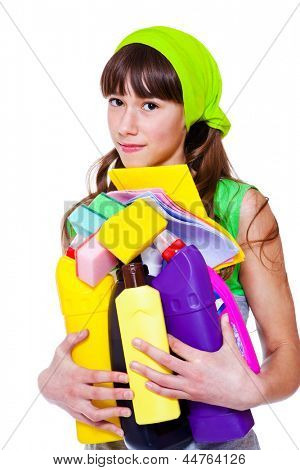Teen girl holding detergents in hands