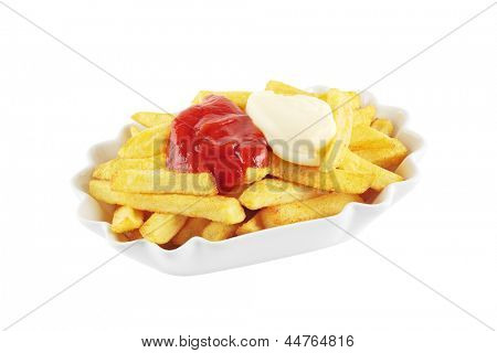 Bowl with french fries topped with mayonnaise and ketchup, isolated on a white background