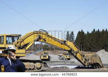 engineer, worker with bulldozers and trucks inside building site