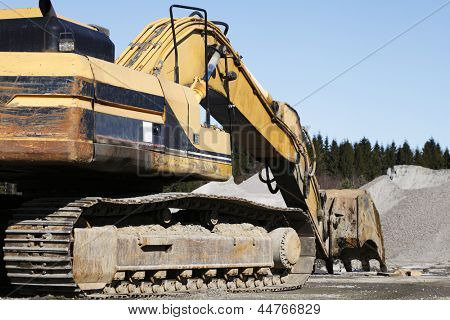 giant super bulldozer seen from the rear side
