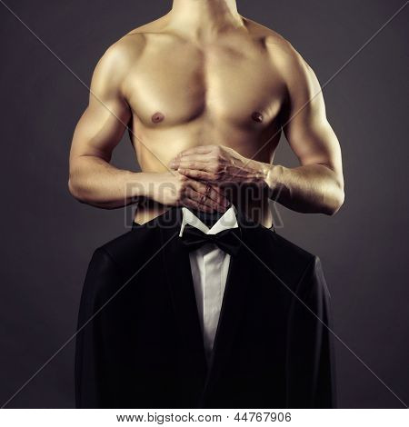 Conceptual photo of naked men and evening suit