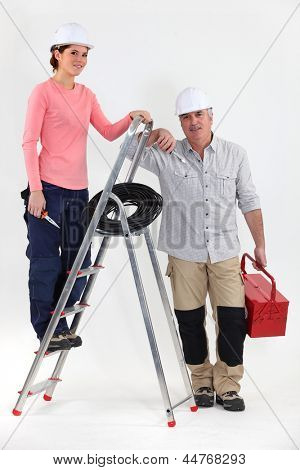 Two electricians with a ladder