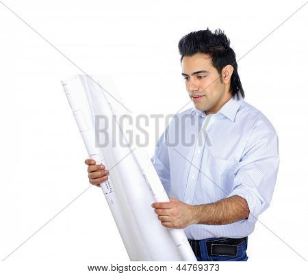 Pensive young businessman comparing something with drafts isolated on white background