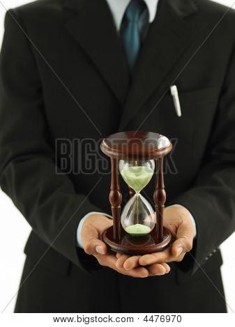 Close Up  A Man Holding An Hour Glass