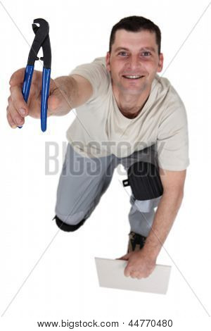 Workman with a pair of pliers