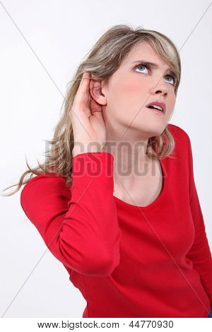 Woman with her hand to her ear