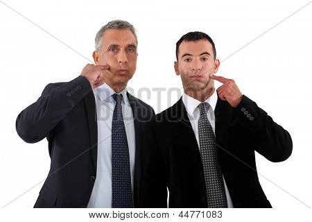 Two men touching her cheek with the index finger