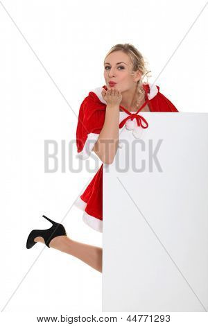 lady wearing a Christmas costume and blowing a kiss