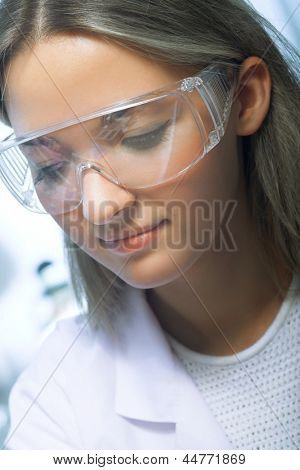young beauty woman in modern research laboratory