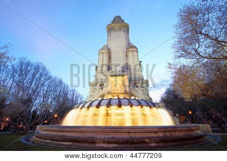 Monument to Cervantes and fountain at spring evening in Madrid, Spain.