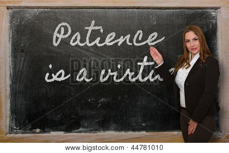 Teacher Showing Patience Is A Virtue On Blackboard