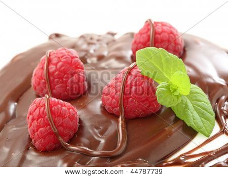 raspberry cover with milk chocolate isolated on white