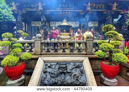 TAIPEI, TAIWAN - JANUARY 12: Worshippers at Longshan Temple January 12, 2013 in Taipei, TW. The temple dates from 1738.