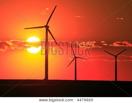 Wind Turbines Against A Setting Sun