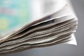 Newspaper concept edge of newspaper pages with shallow depth of field