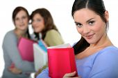 stock photo of backstabbers  - Young woman at school - JPG