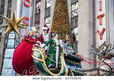 Santa & Mrs. Claus on their sleigh