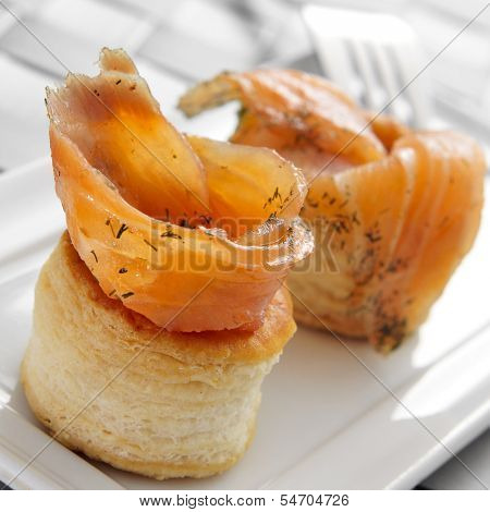 a plate with some volauvents filled with smoked salmon, served as appetizer