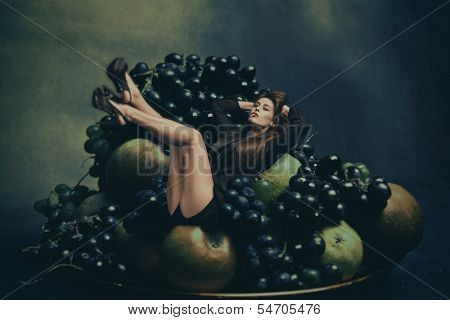 fashion woman in black tuxedo and high heel shoes lies in plate with fruits, photo compilation