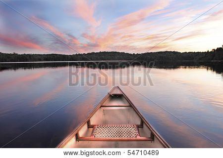 Canoe Bow On A Lake At Sunset
