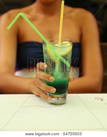Green alcoholic cocktail in a tall glass